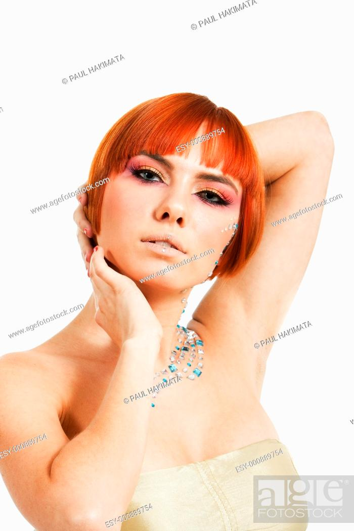 Stock Photo: Beautiful redhead Caucasian girl with rhinestones and arms around her head, isolated.