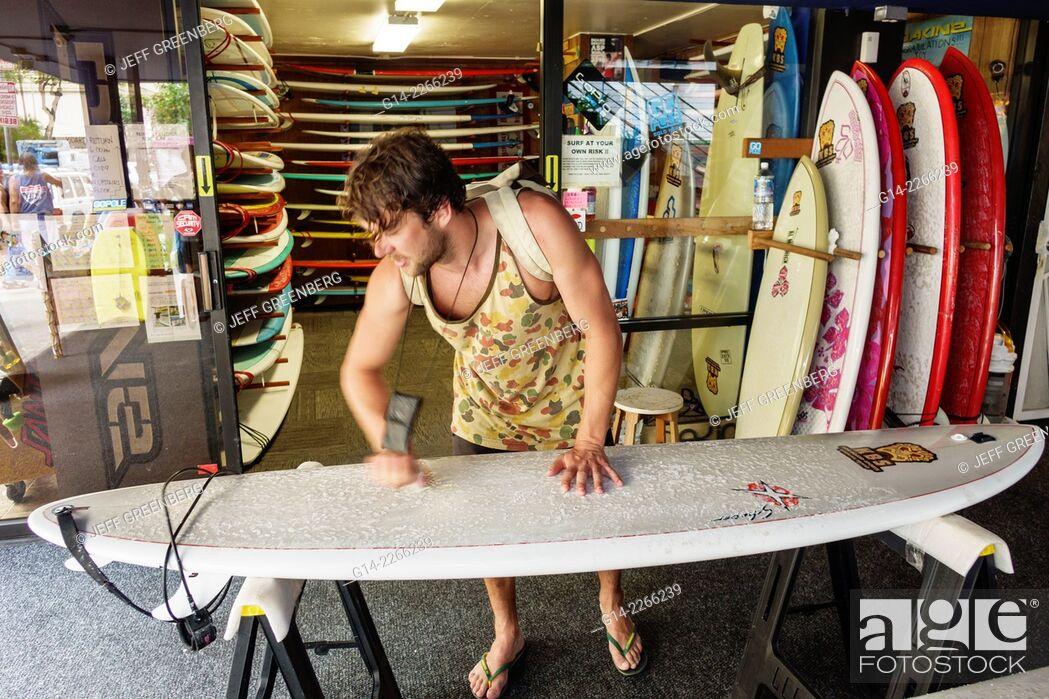 Stock Photo: Hawaii, Hawaiian, Oahu, Honolulu, Waikiki Beach, Kings Village Shopping Center, shopping, surfboard shop, man, waxing, sale, rental.