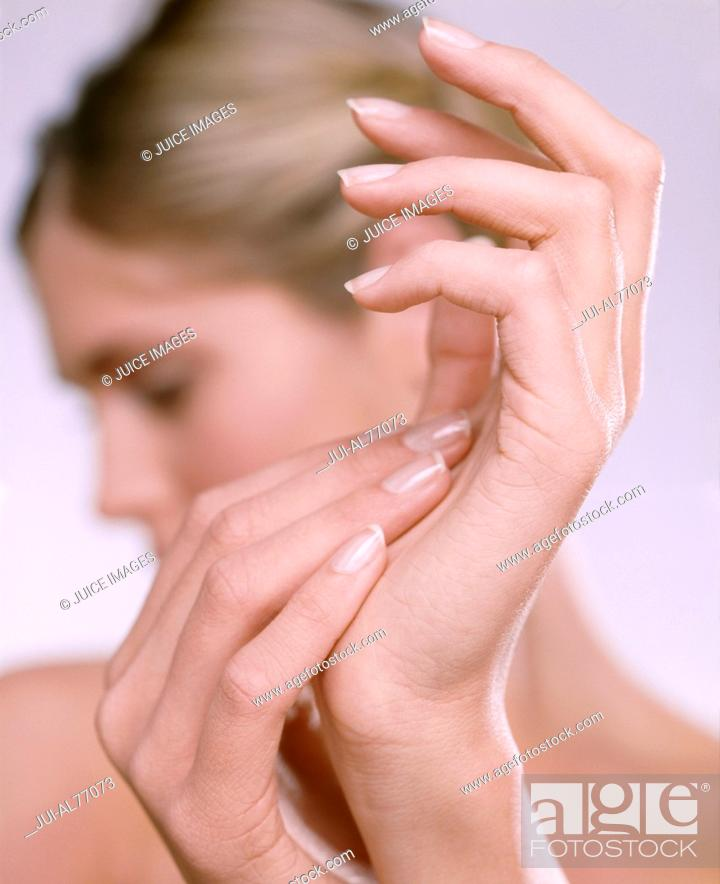 Stock Photo: Close-up of a young woman's hands.
