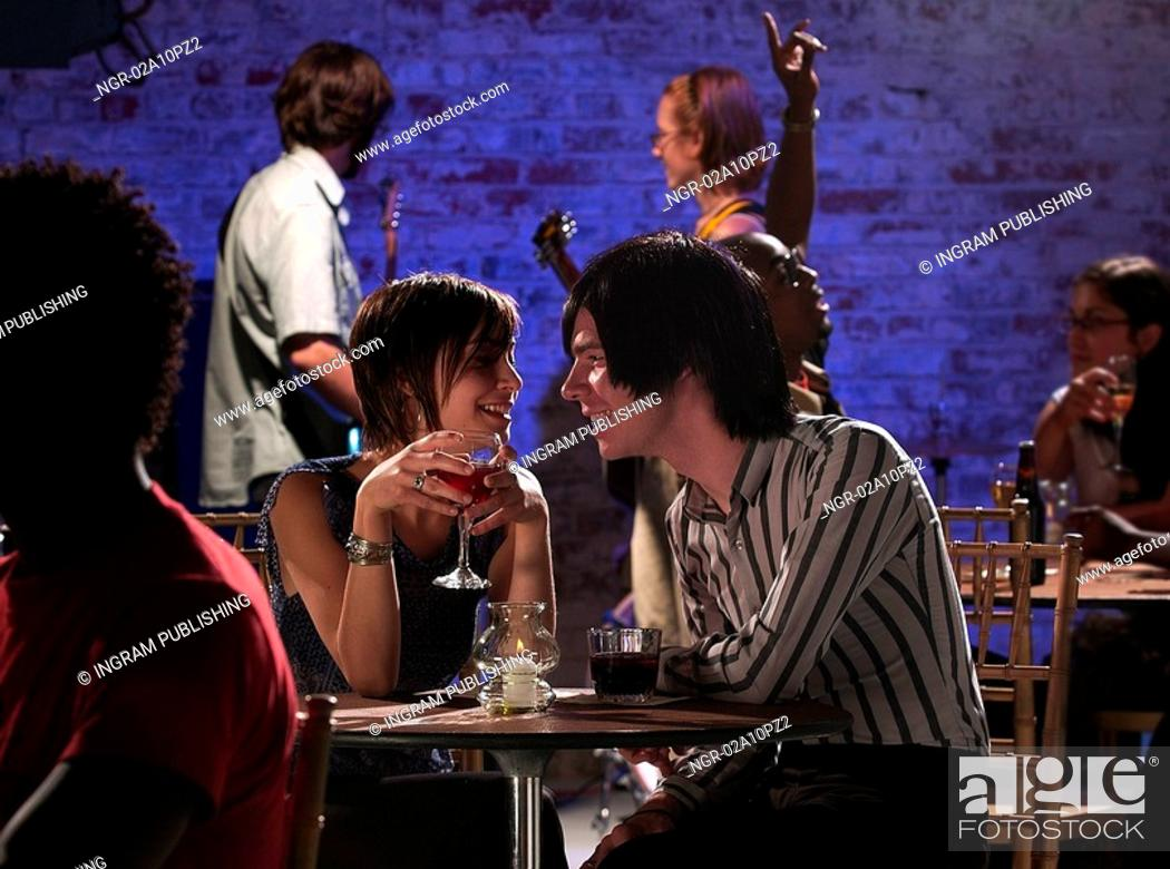 Stock Photo: young couple at a bar.