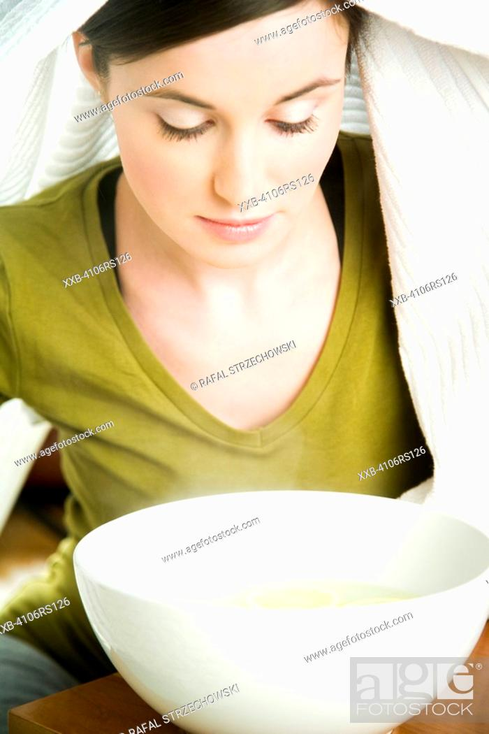 Stock Photo: young woman inhaling vapors.