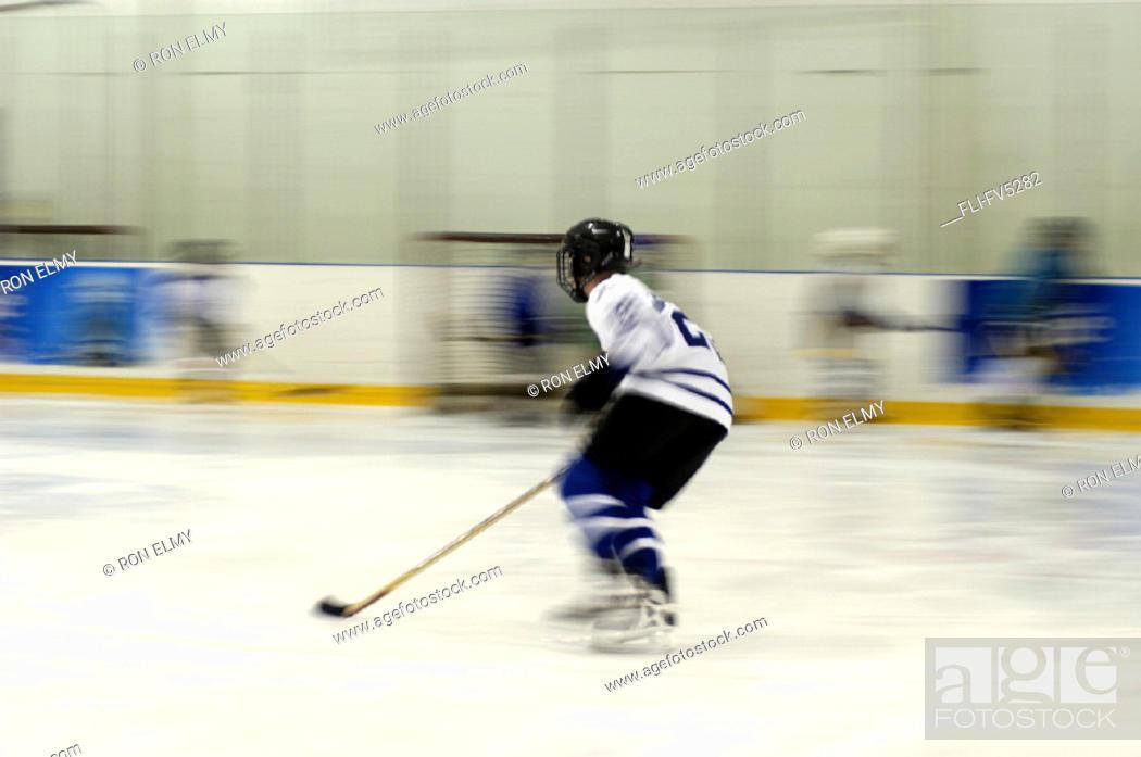 Stock Photo: FV5282, Ron Elmy, Boy Playing Hockey.