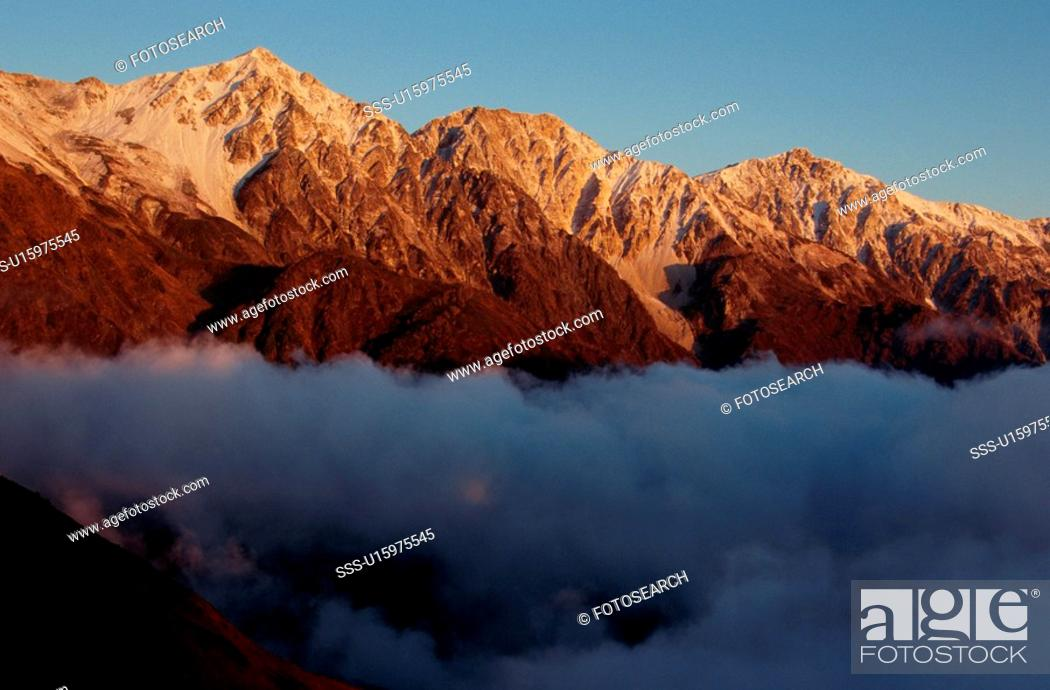 Stock Photo: Mountains Above Clouds.