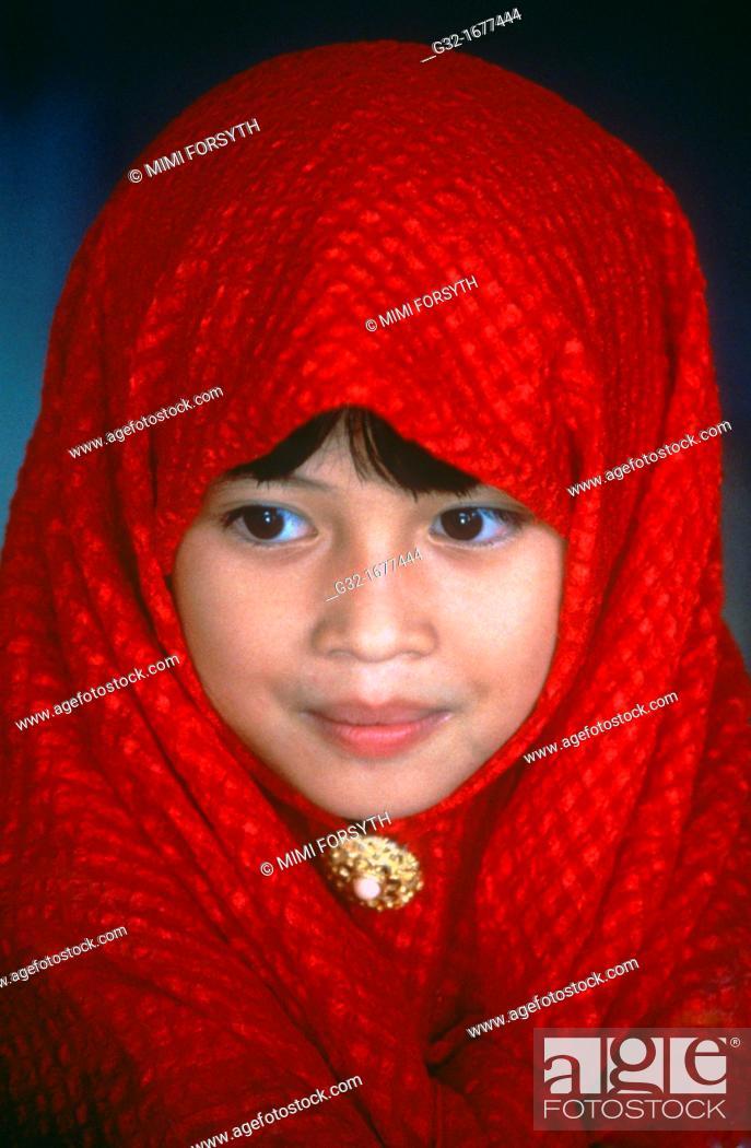 Stock Photo: Muslim girl in red hijab, Sabah, Malaysia.
