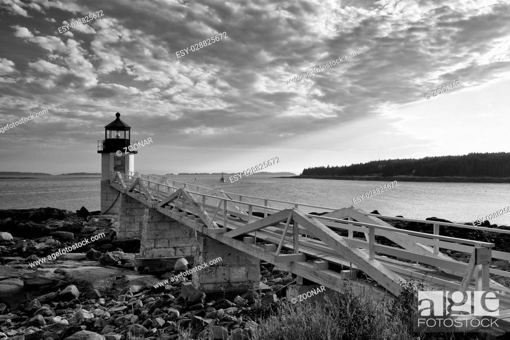 Stock Photo: Marshall Point Light as seen from the rocky coast of Port Clyde - Black and White Photo.