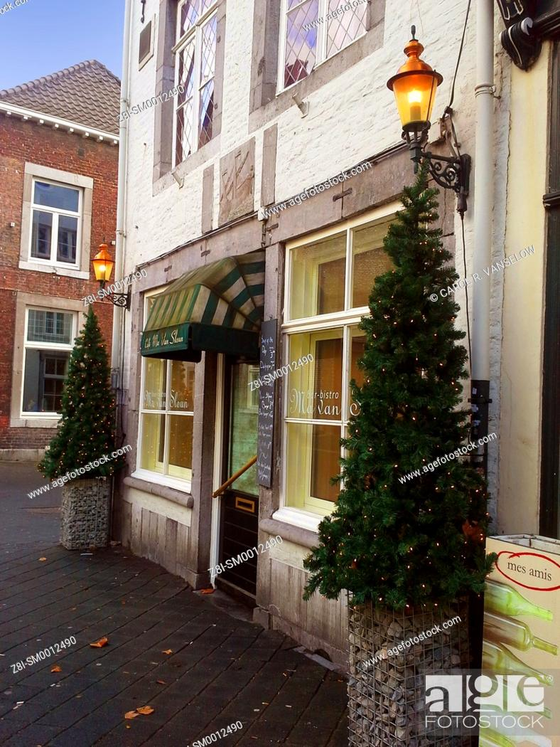 Stock Photo: Christmas decorations in front of cafe on side street in Maasticht.