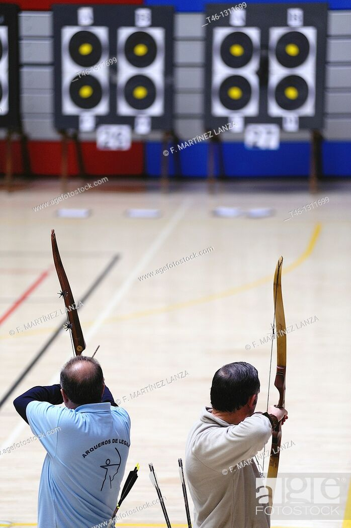 Stock Photo: Archers firing arrows at the targets.