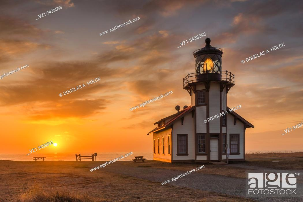 Stock Photo: Setting Sun on Pt. Cabrillo Lighthouse Medocino Coast CA.