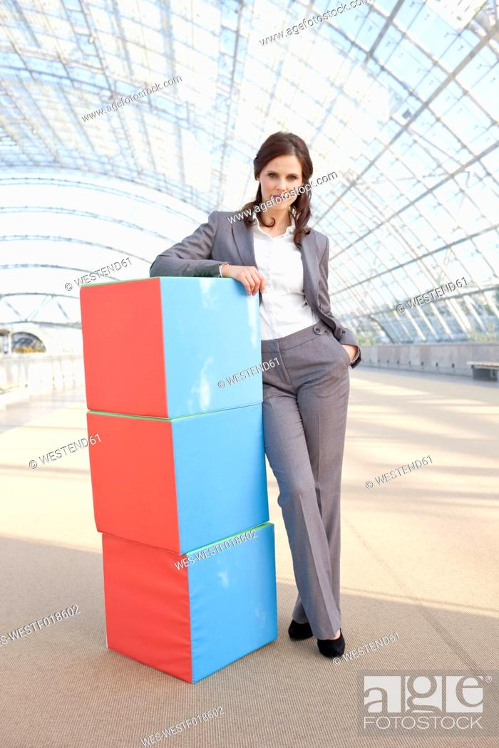 Stock Photo: Germany, Leipzig, Businesswoman with cubes, portrait.
