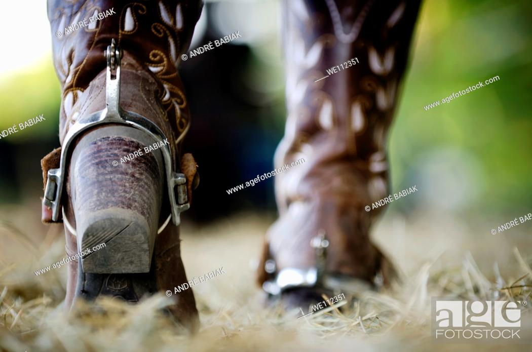 Stock Photo: Western boots with spurs.