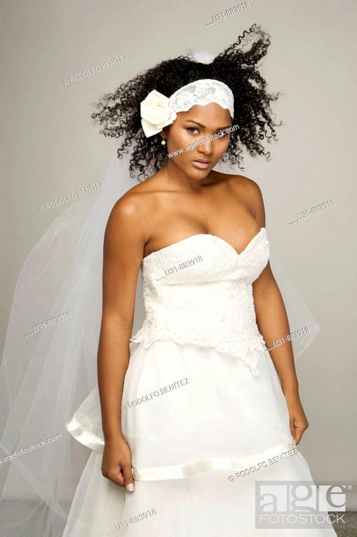 Stock Photo: Black Latin Bride in her 20s poses in a studio setting.