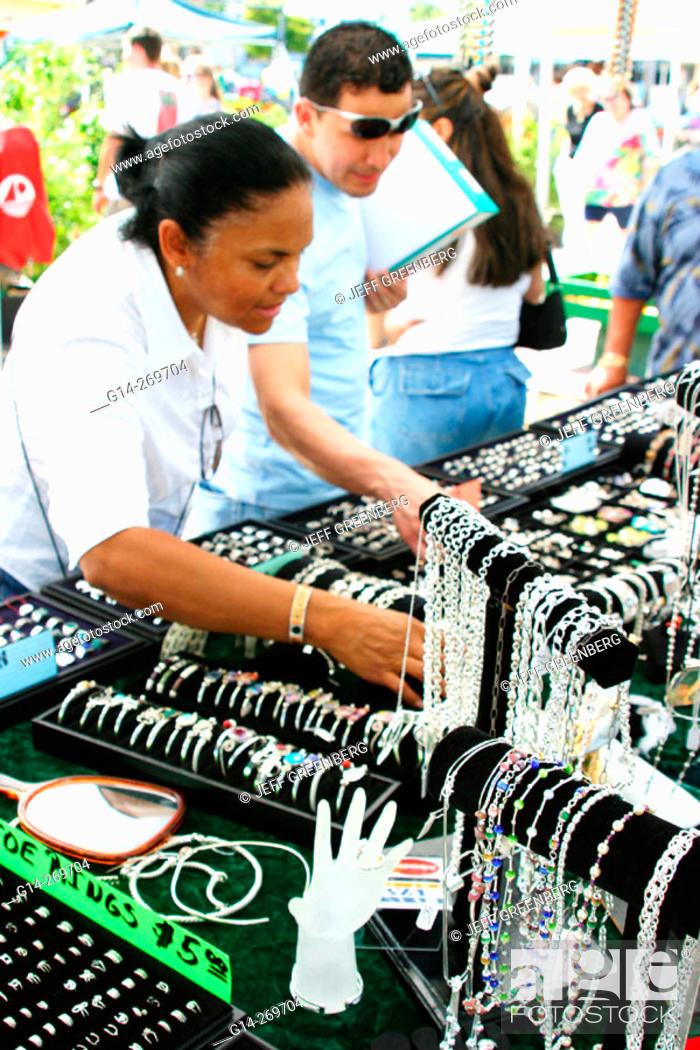 Stock Photo Woman Inspecting Jewelry For Sunday Flea Market Miami Beach