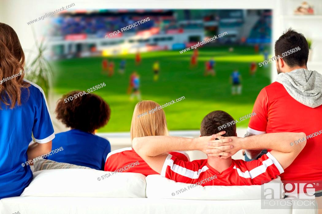 Stock Photo: friends or football fans watching soccer at home.