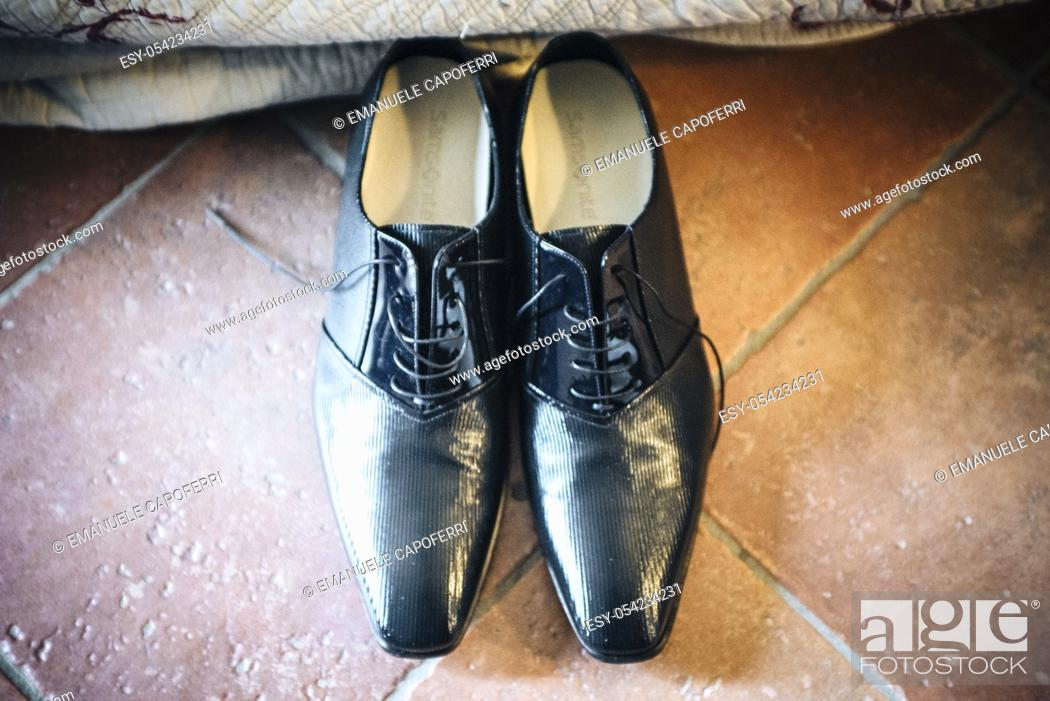 Stock Photo: elegant black groom shoes.