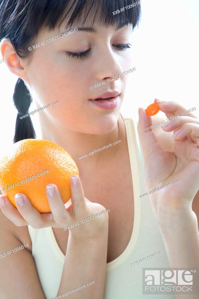 Stock Photo: woman with orange and vitamin.