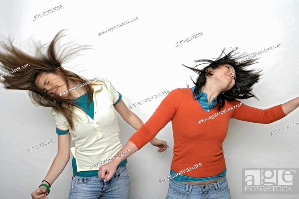 Stock Photo: View of two teenage girls going wild.