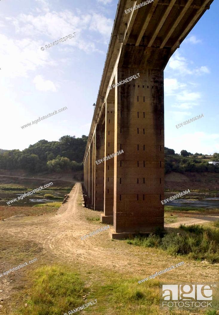 Stock Photo: Pillars of a bridge in the Minho river, Galicia, Spain.