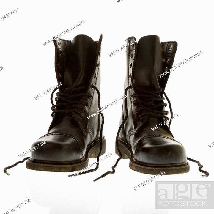 Stock Photo: Black leather high top boots with untied laces.