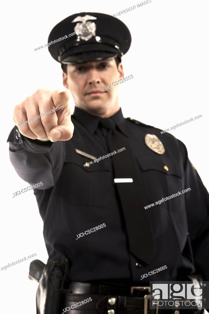 Stock Photo: Male police officer pointing.