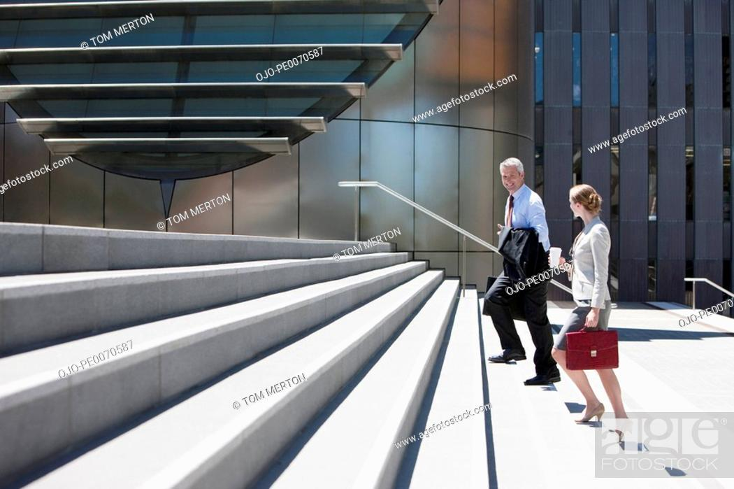 Stock Photo: Business people walking up steps.