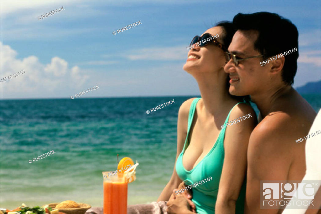 Stock Photo: Young couple embracing on the beach.