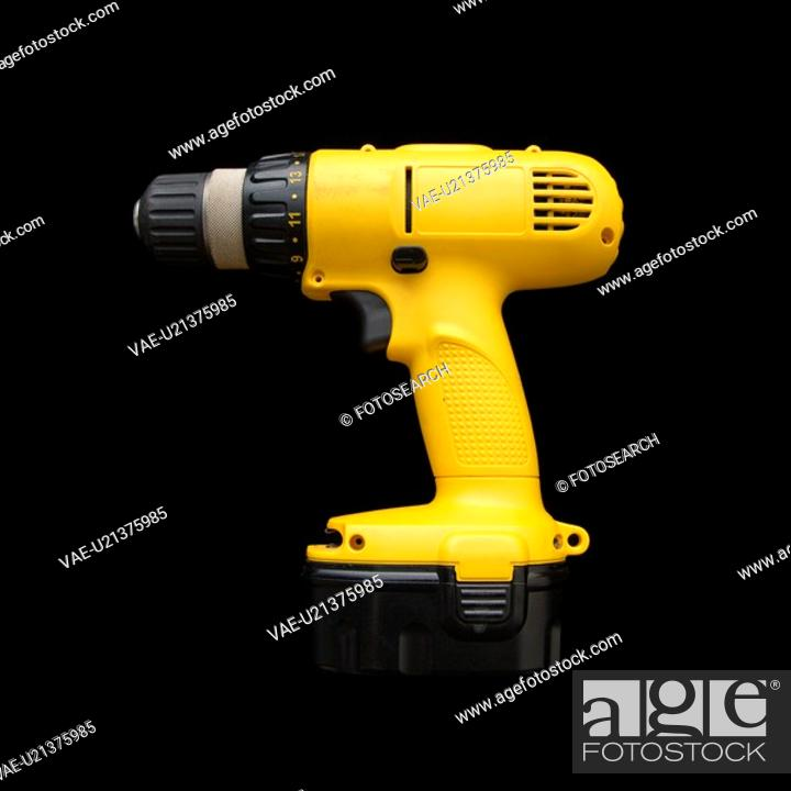 Stock Photo: Cordless rechargeable electric drill.