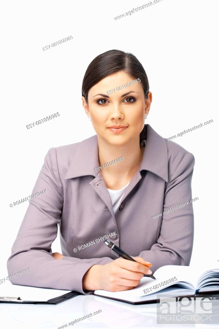 Stock Photo: Portrait of a young beautiful businesswoman writing in the diary over white.