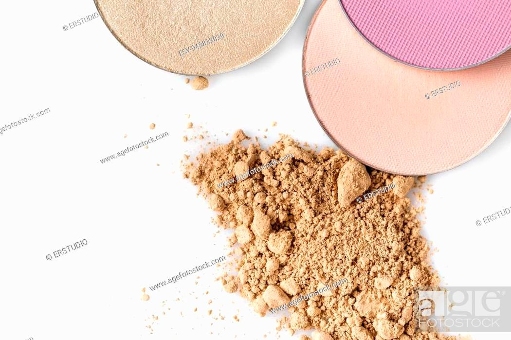 Stock Photo: Beige powder for the face and round eye shadow on a white background. Natural make up.