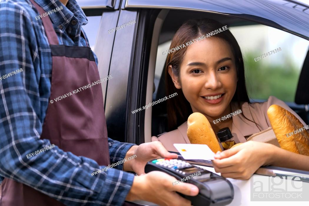 Stock Photo: Portrait of asian woman make mobile payment contactless technology for online grocery ordering and drive thru service. Drive through and food online is new.