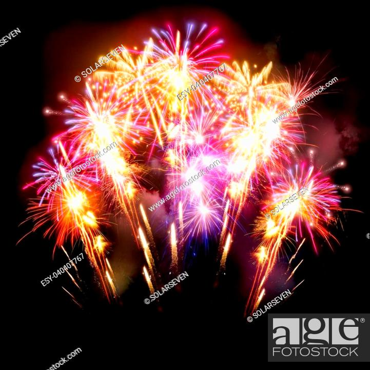 Stock Photo: Colourful golden and pink fireworks display for celebrations.