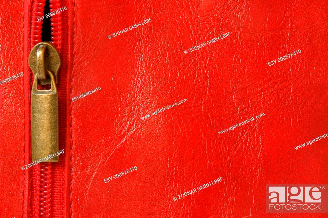 Stock Photo: Red leather with zipper.