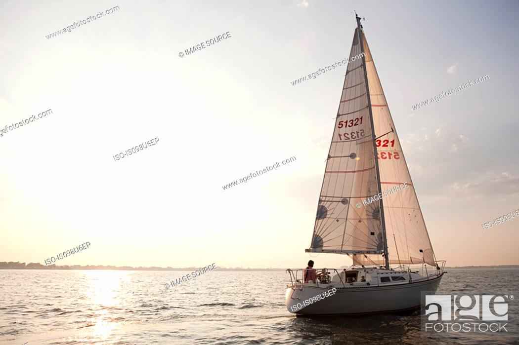 Stock Photo: Yacht sailing on sea.