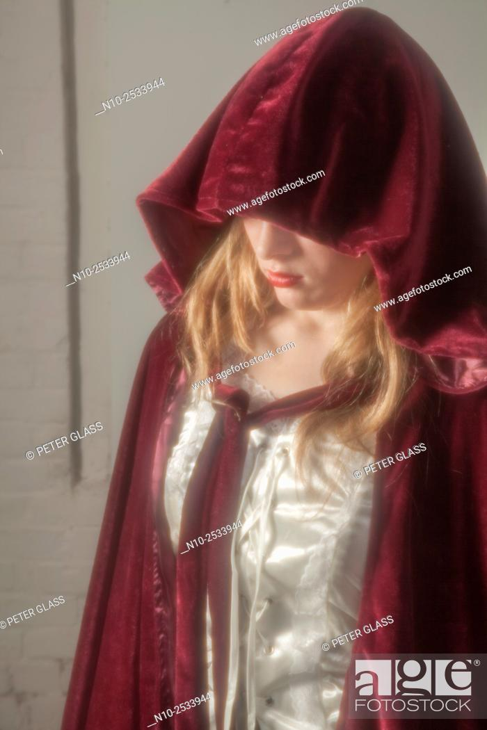 Stock Photo: Blonde teenage girl wearing a robe with a hood.