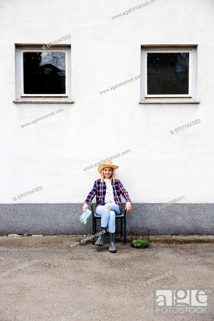 Stock Photo: Young woman gardening.