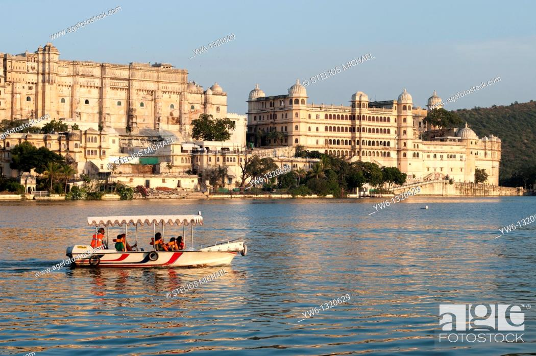 Stock Photo: Udaipur City Palace with Tourist Boat.