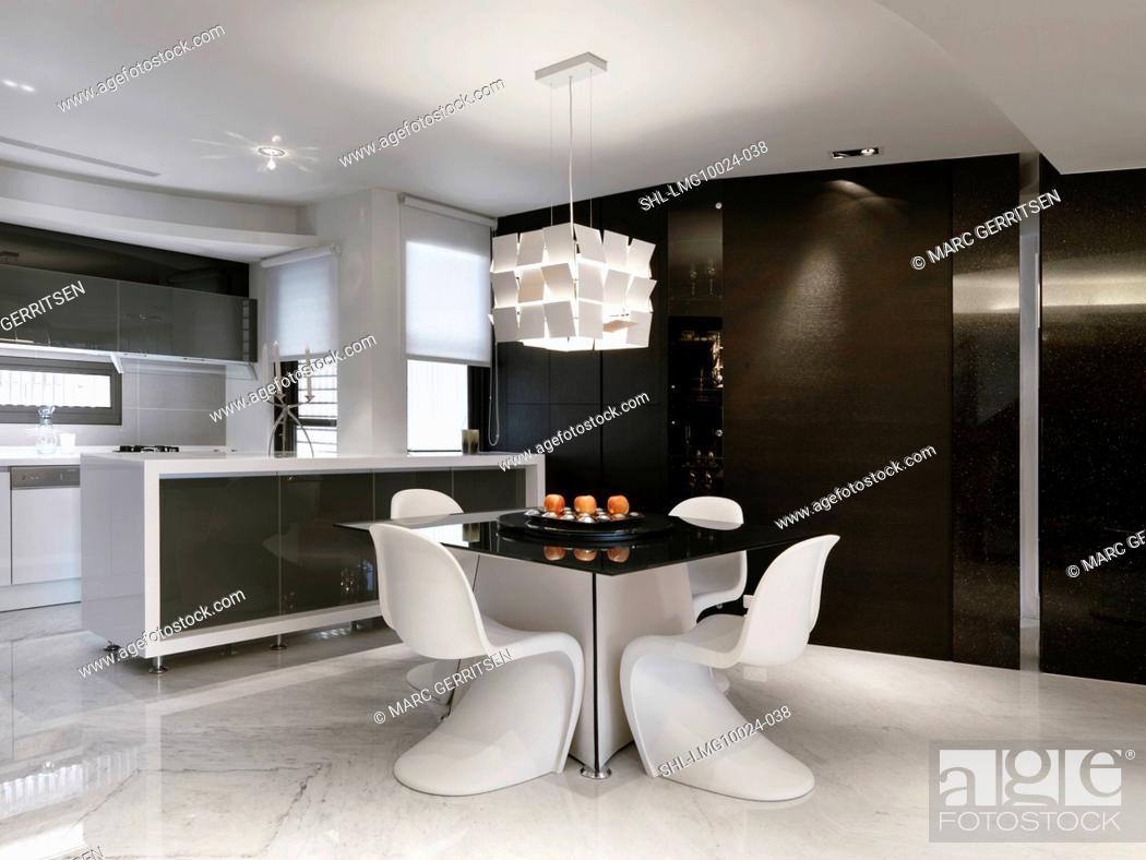 Imagen: Kitchen table in modern black and white kitchen.