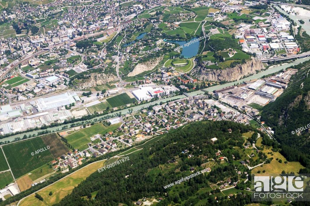 Stock Photo: Aerial view of Siders, Sierre, with the lake Grand Lac, Valais, Switzerland.