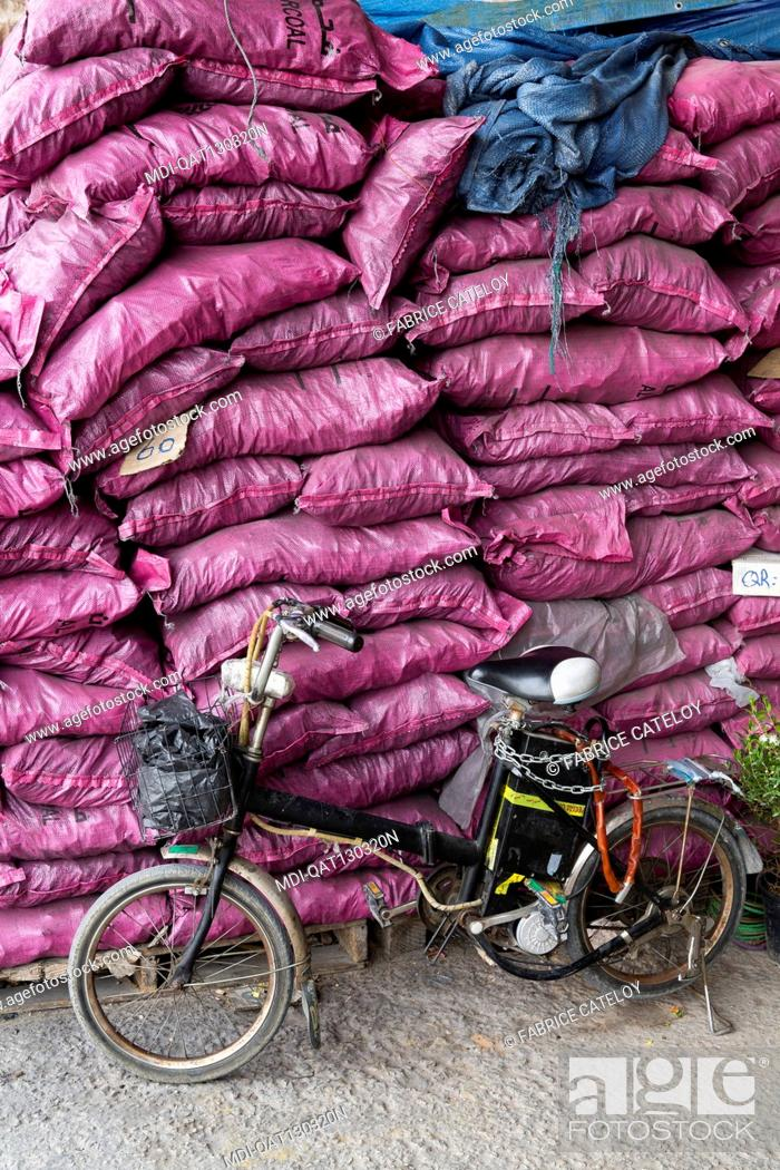 Imagen: Qatar - Doha - Wholesale market - The plant and product market - Bags of charcoal.