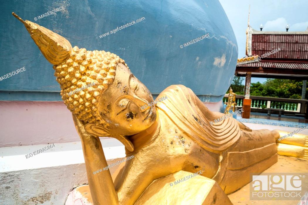 Stock Photo: Reclining golden statue in buddhist temple, Koh Samui, Thailand.