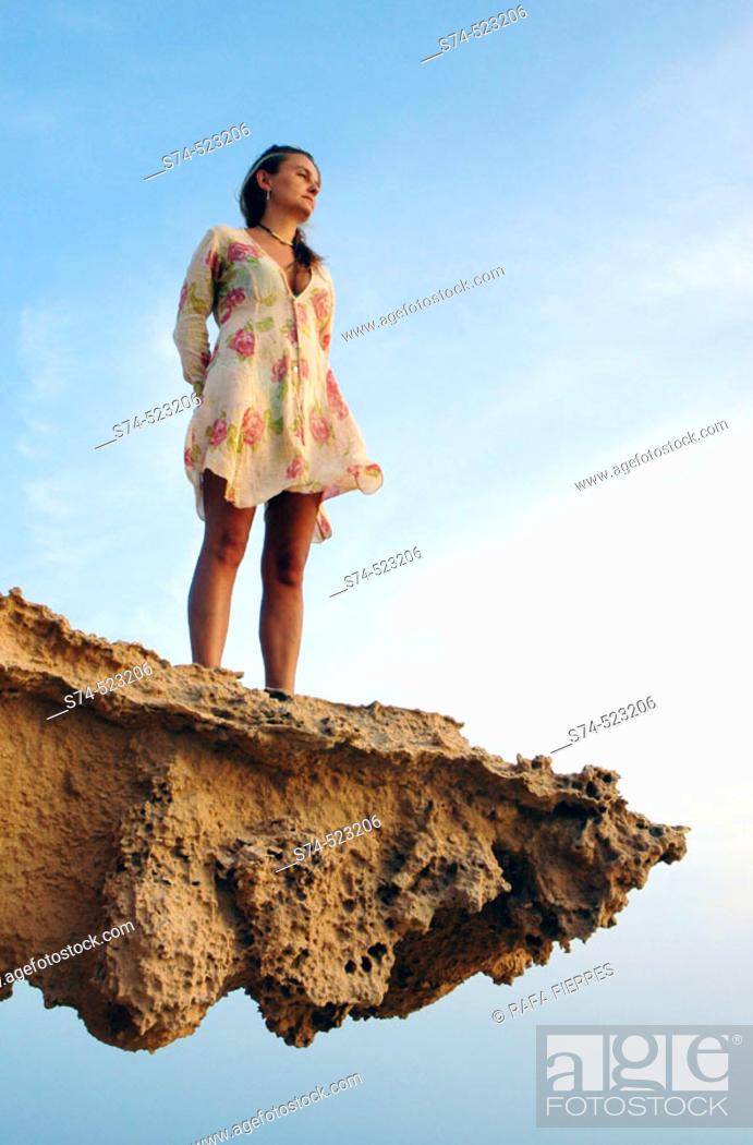 Stock Photo: Woman on a sandstone rock formation. Formentera. Balearic Islands. Spain.