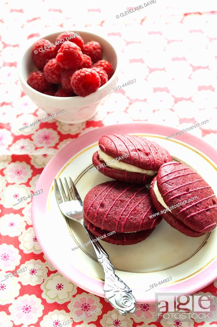 Stock Photo: Whoopie pies with raspberries.
