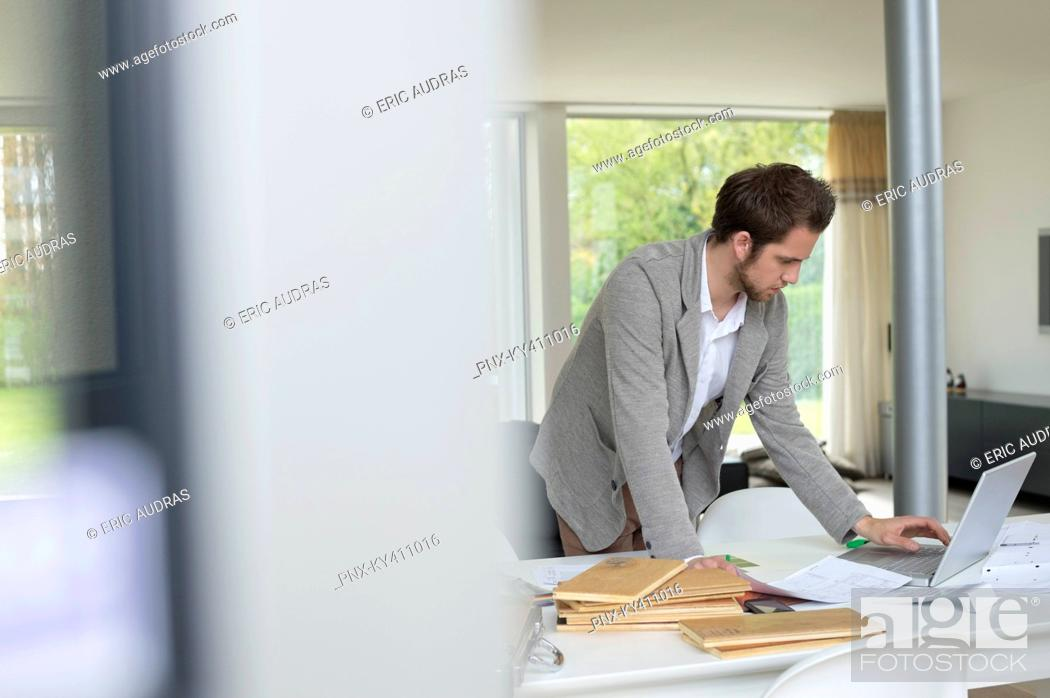 Stock Photo: Interior designer working on a laptop in the office.