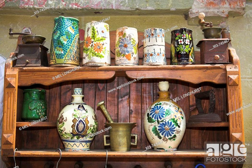Stock Photo: Antique pottery items for sale on shelving outside an antique shop, Sighisoara, Transylvania, Romania.