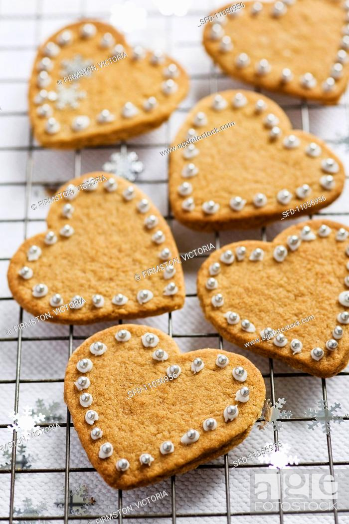 Stock Photo: Heart-shaped cinnamon biscuits decorated with sugared beads.