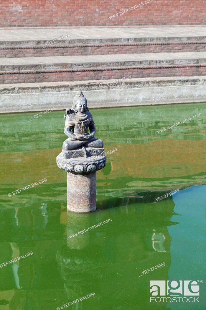 Stock Photo: Buddha statue in a green pond, Bhaktapur, Nepal.