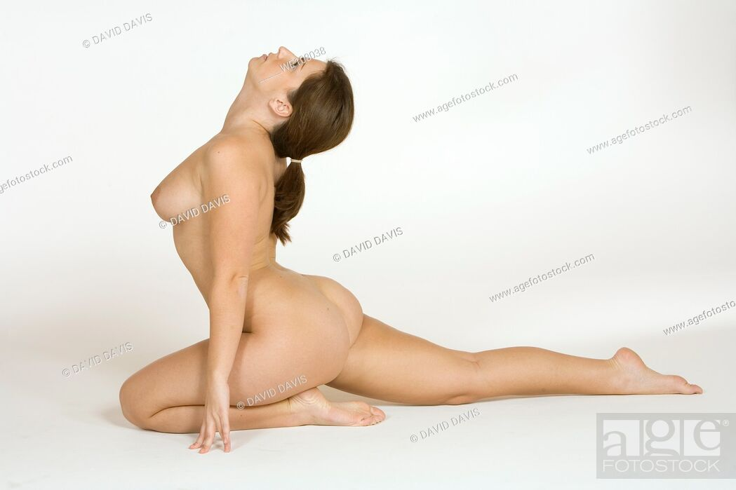Stock Photo: Very sexy and beautiful Caucasian woman posing nude on a white background.