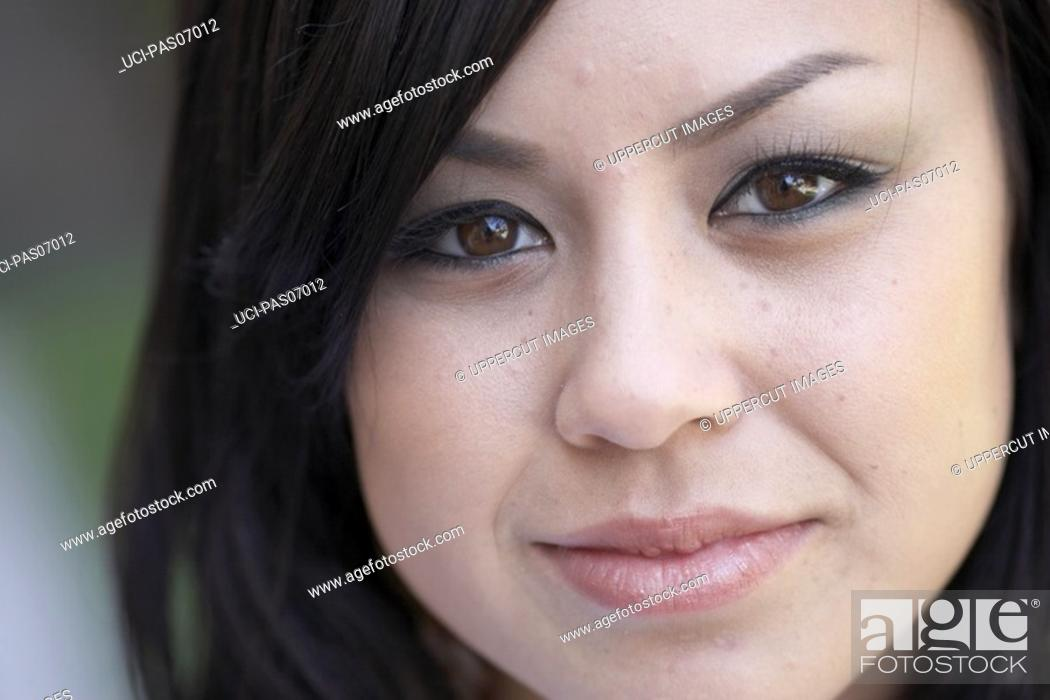 Stock Photo: Close up of young woman's face.
