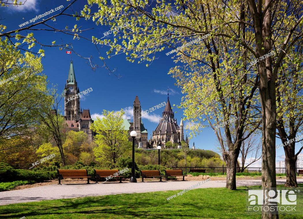 Stock Photo: The Parliament Building view from a park in Ottawa, Ontario, Canada springtime daytime scenic May 2017.