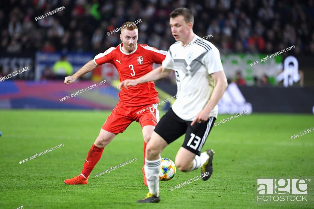 Stock Photo: duels, duel between Miroslav Bogosavac (Serbia) and Lukas Klostermann (Germany). GES / Football / Test Match: Germany - Serbia, 20.03.