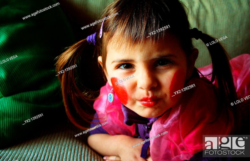 Stock Photo: Portrait of girl with pigtails.